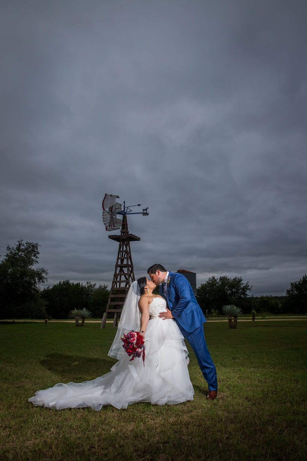 Laura wedding Western Sky couple kiss windmill