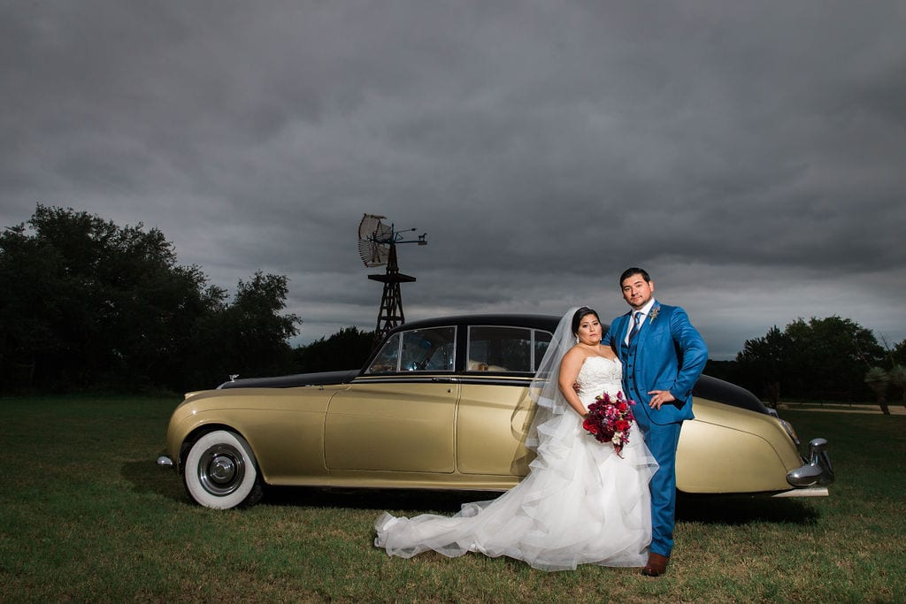 Laura wedding Western Sky couple kiss with rolls royce
