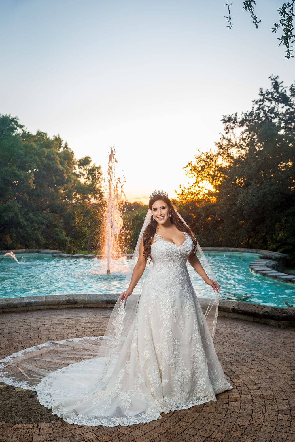 Mary Elizabeth's bridal at the McNay the fountain holding veil