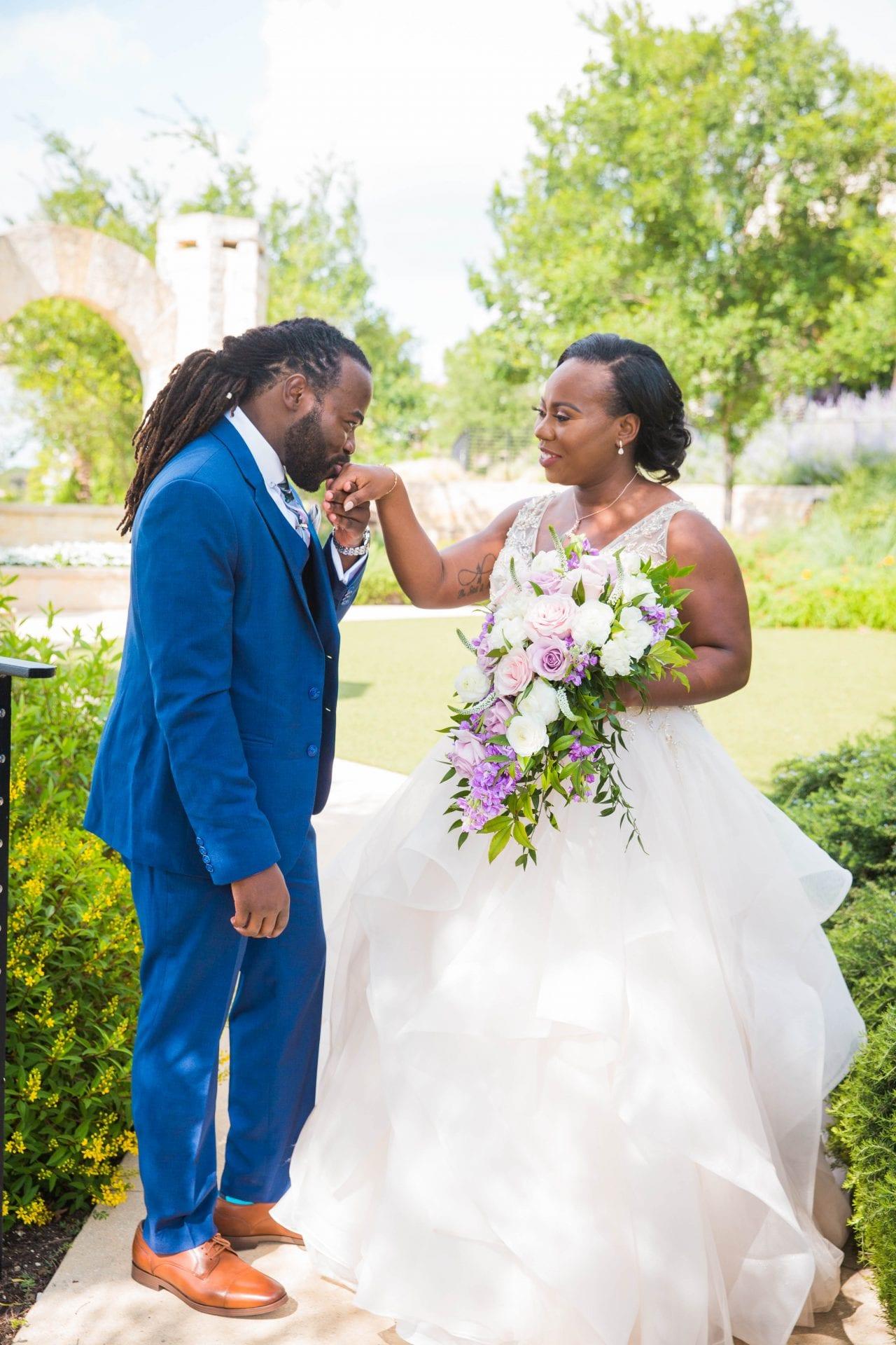 Onyema wedding La Cantera first look hand kiss