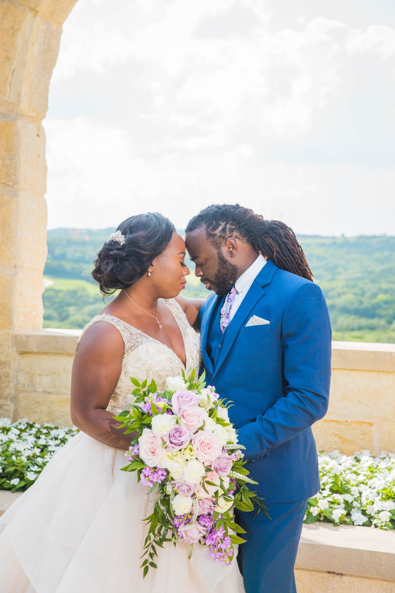 Onyema wedding La Cantera arches heads touching