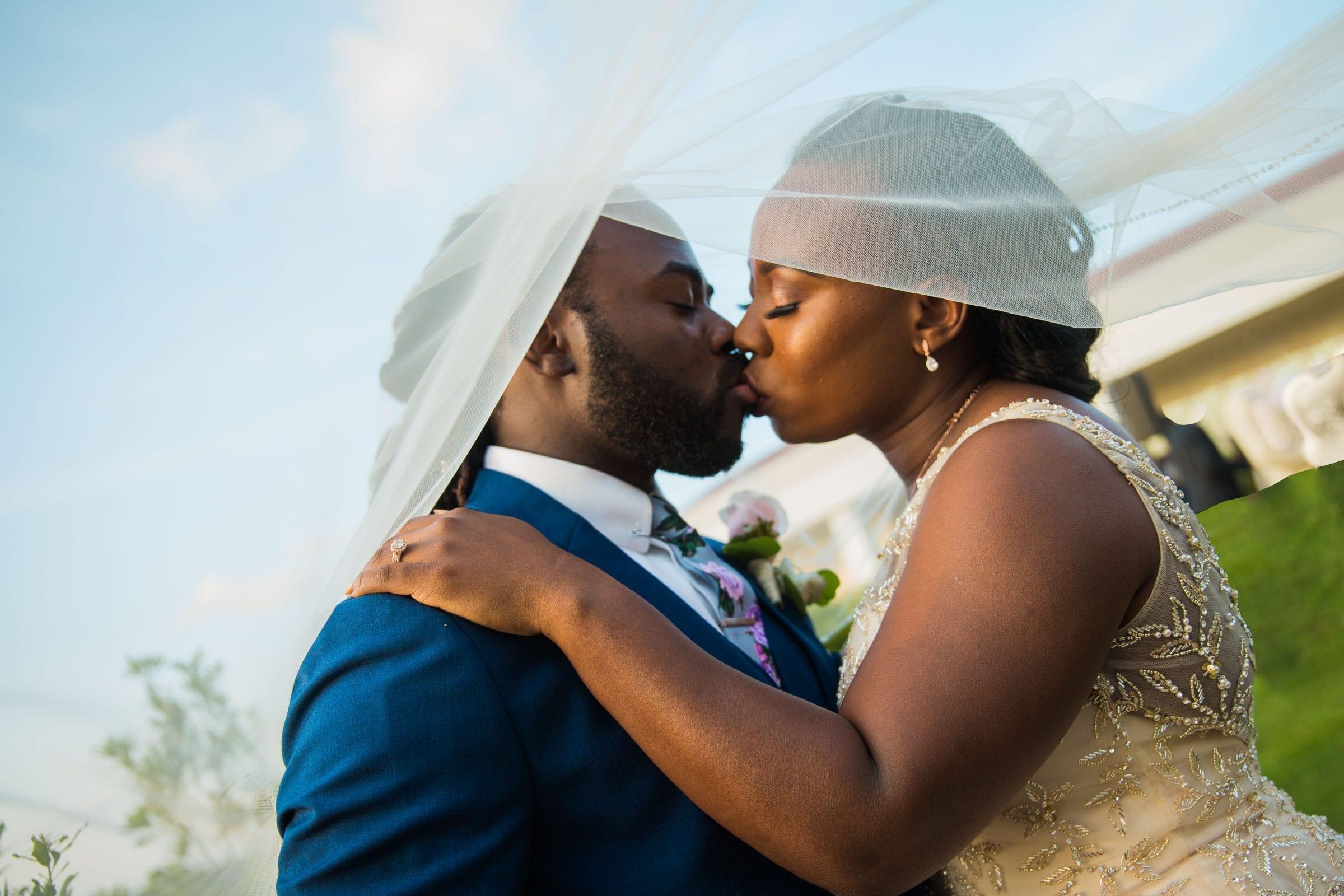 Onyema wedding La Cantera couple under veil tilted