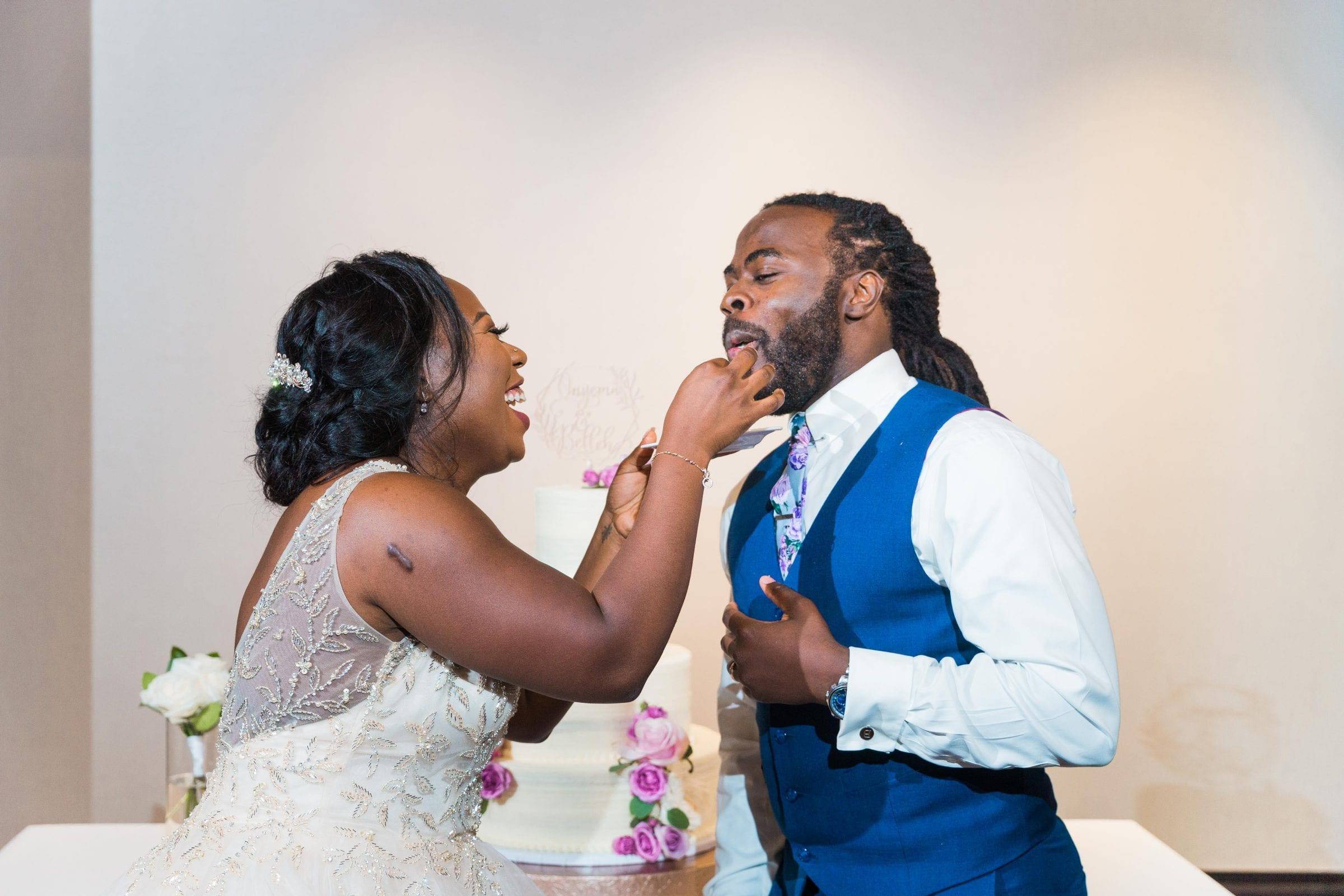 Onyema wedding La Cantera cake feeding