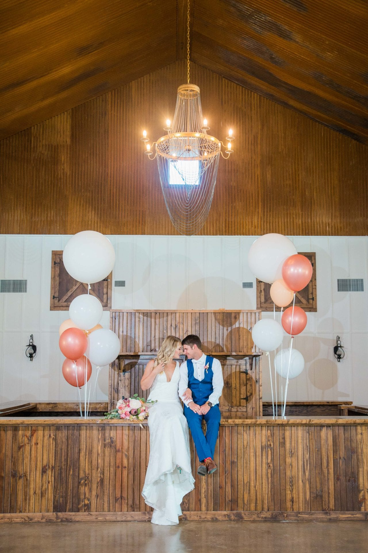 Western Sky Styled shoot couple sitting on bar