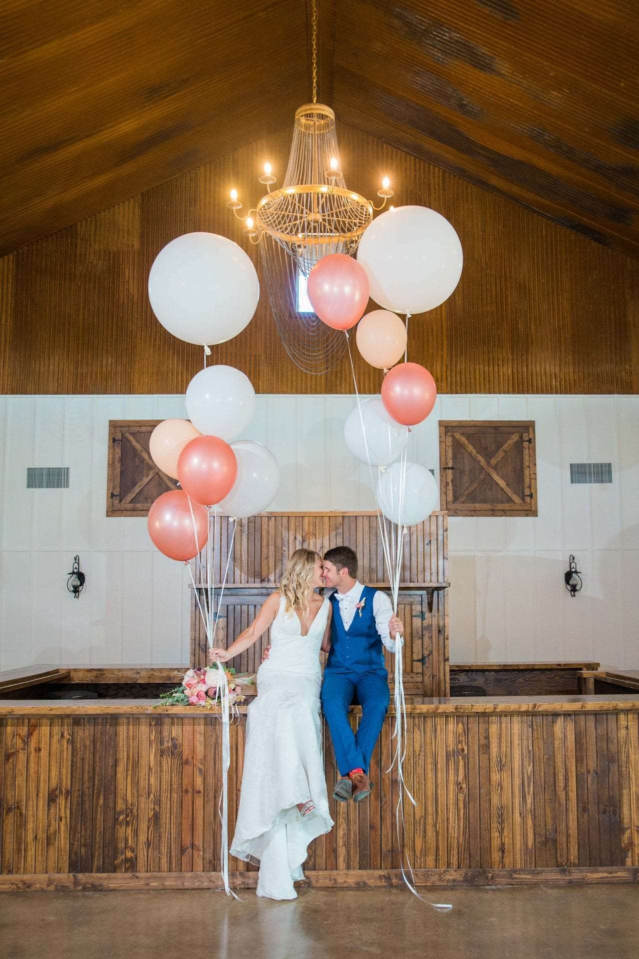 Western Sky Styled shoot couple kissing on bar