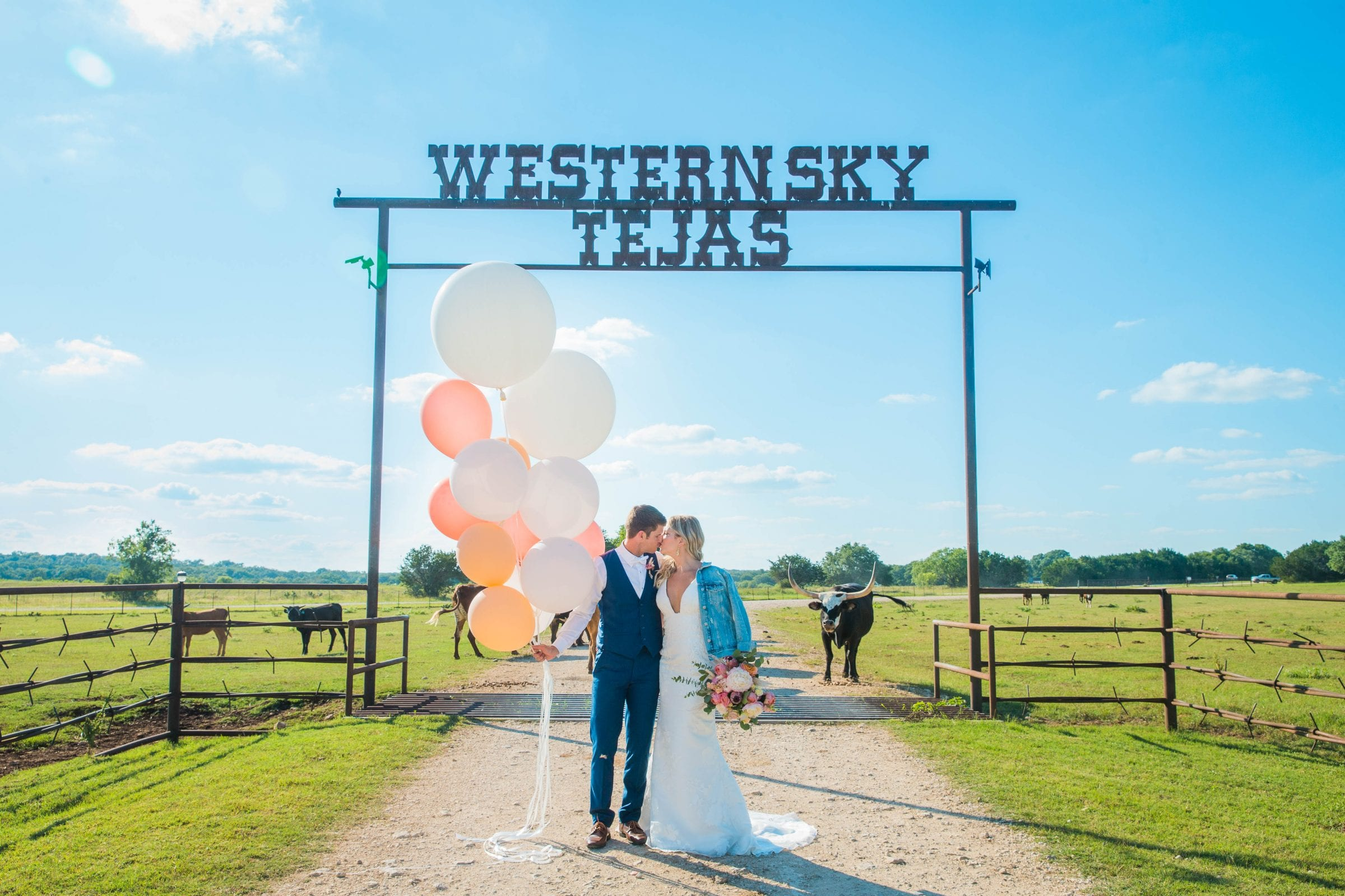 Western Sky Styled shoot couple with cows