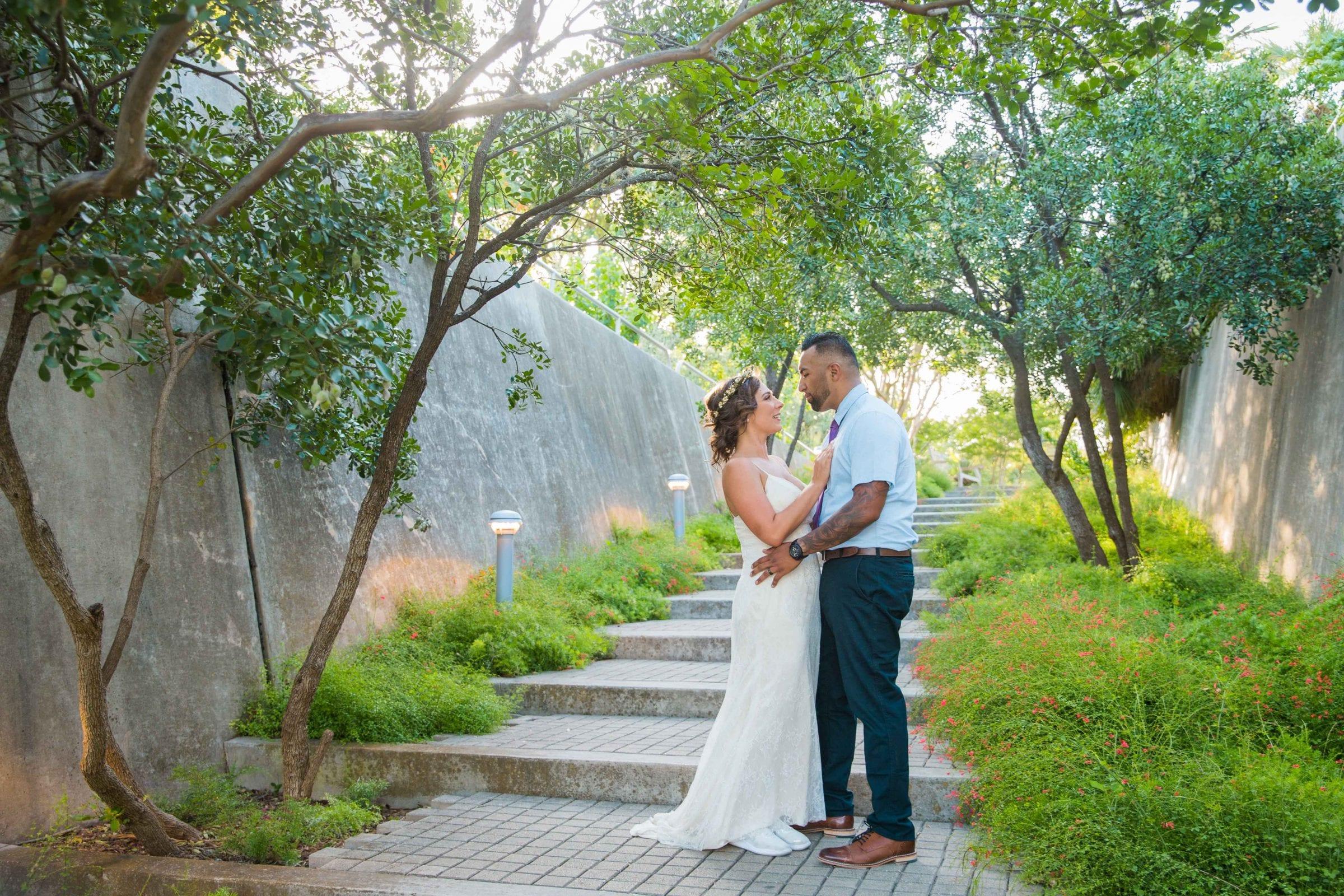 Courtney Amaya wedding San Antonio Botanical Garden couple on the stairs