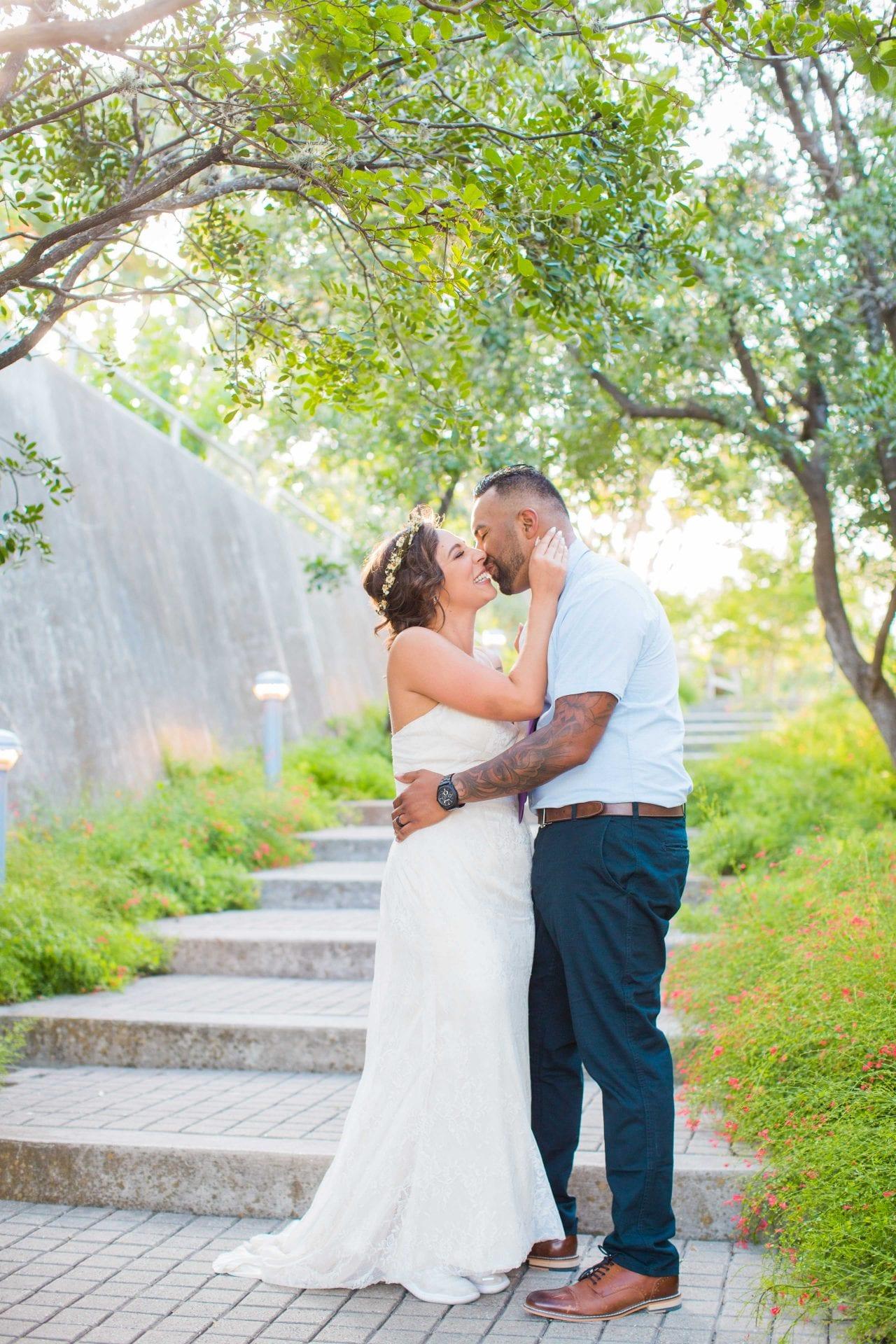 Courtney Amaya wedding San Antonio Botanical Garden couple on the stairs kissing