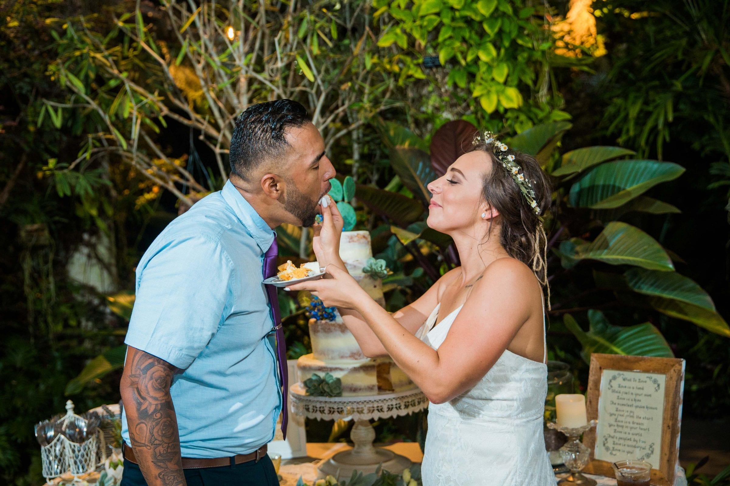 Courtney Amaya wedding San Antonio Botanical Garden cake feeding