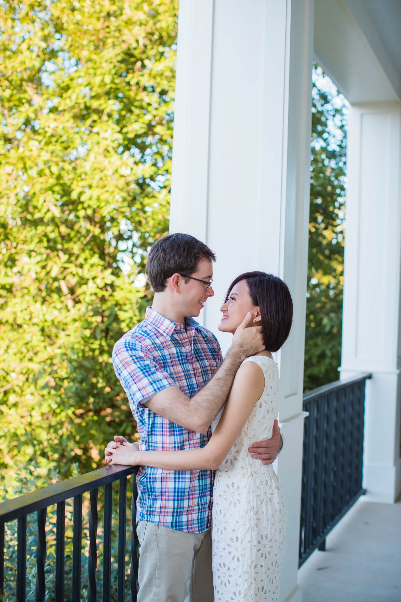 Josh and Tina engagement session at Kendall plantation on the porch