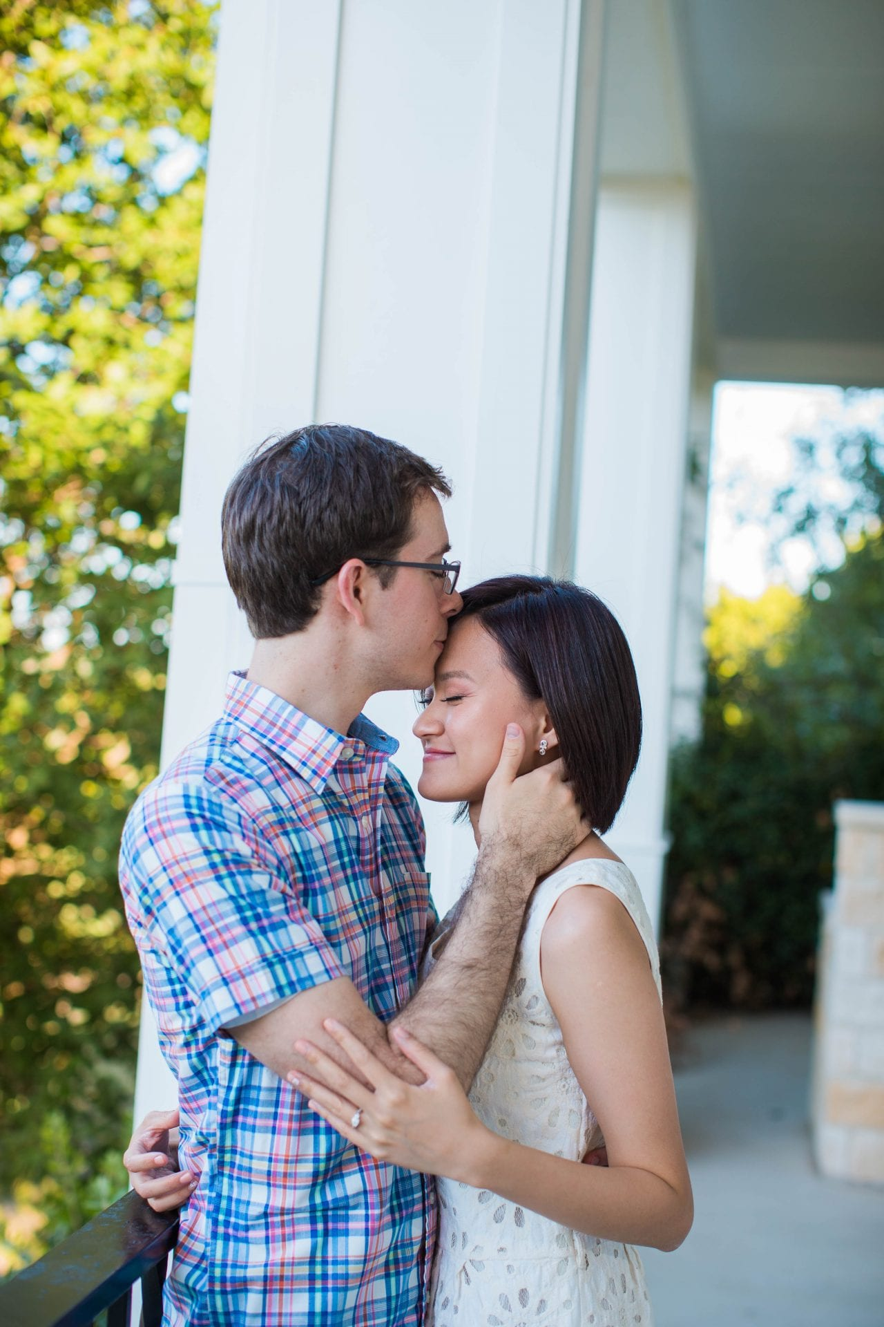 Josh and Tina engagement session at Kendall plantation kiss on the porch