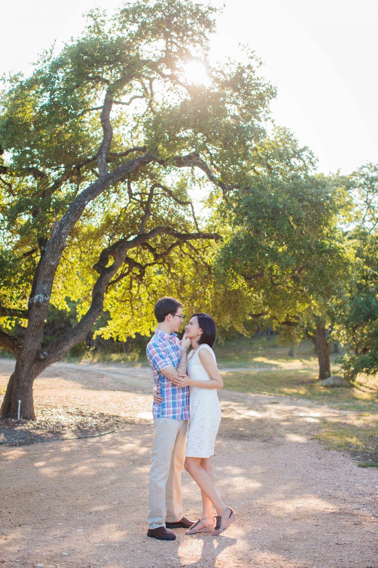 Josh and Tina engagement session at Kendall plantation hug on path under trees