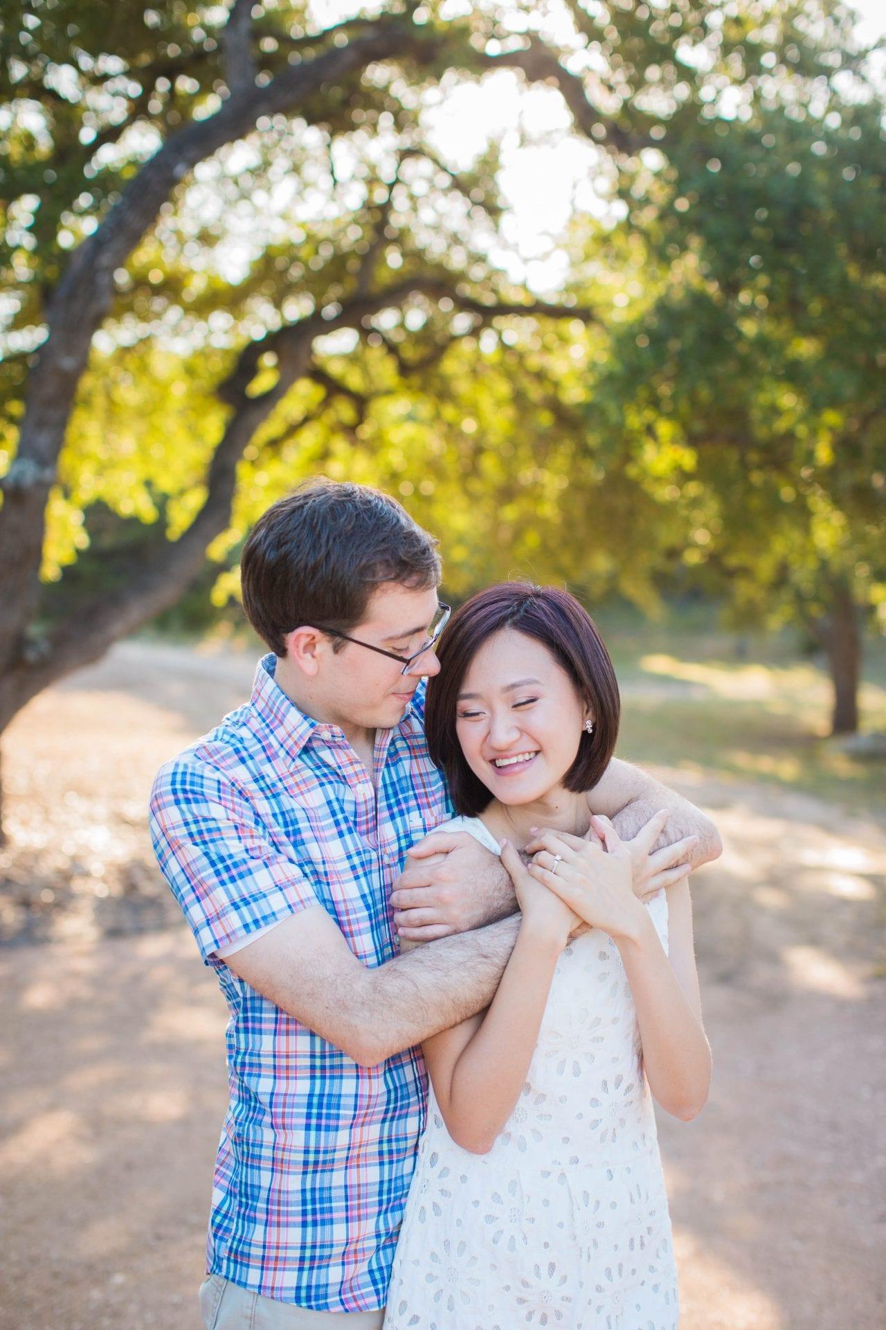 Josh and Tina engagement session at Kendall plantation hug on path