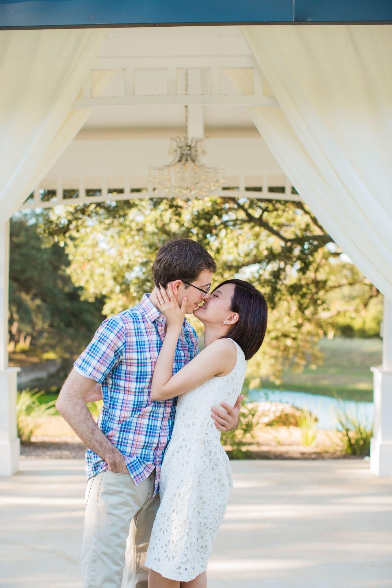 Josh and Tina engagement session at Kendal plantation kiss in the gazebo