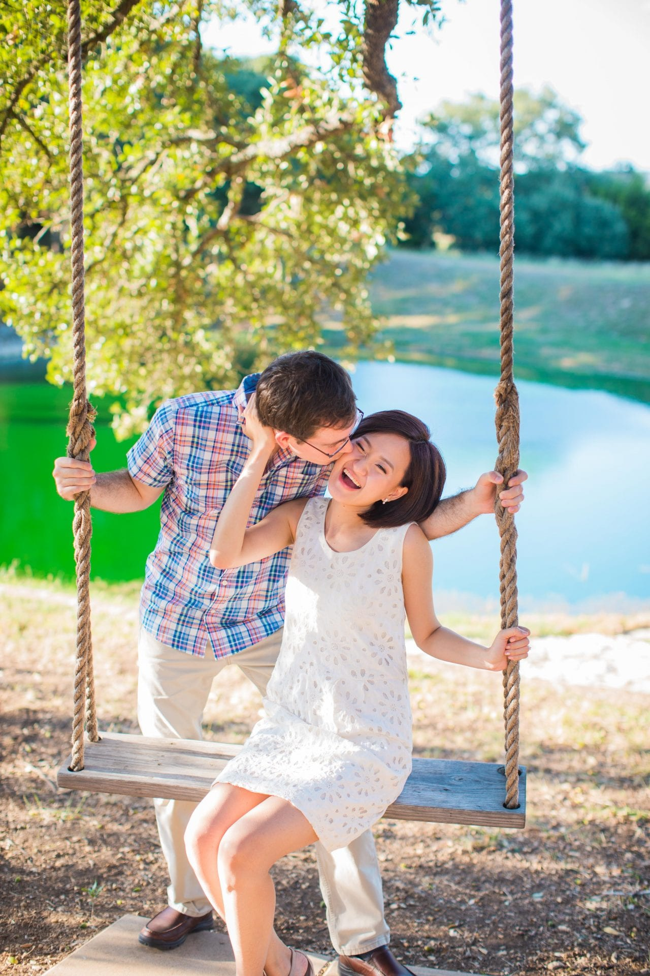 Josh and Tina engagement session at Kendall plantation sitting on swing