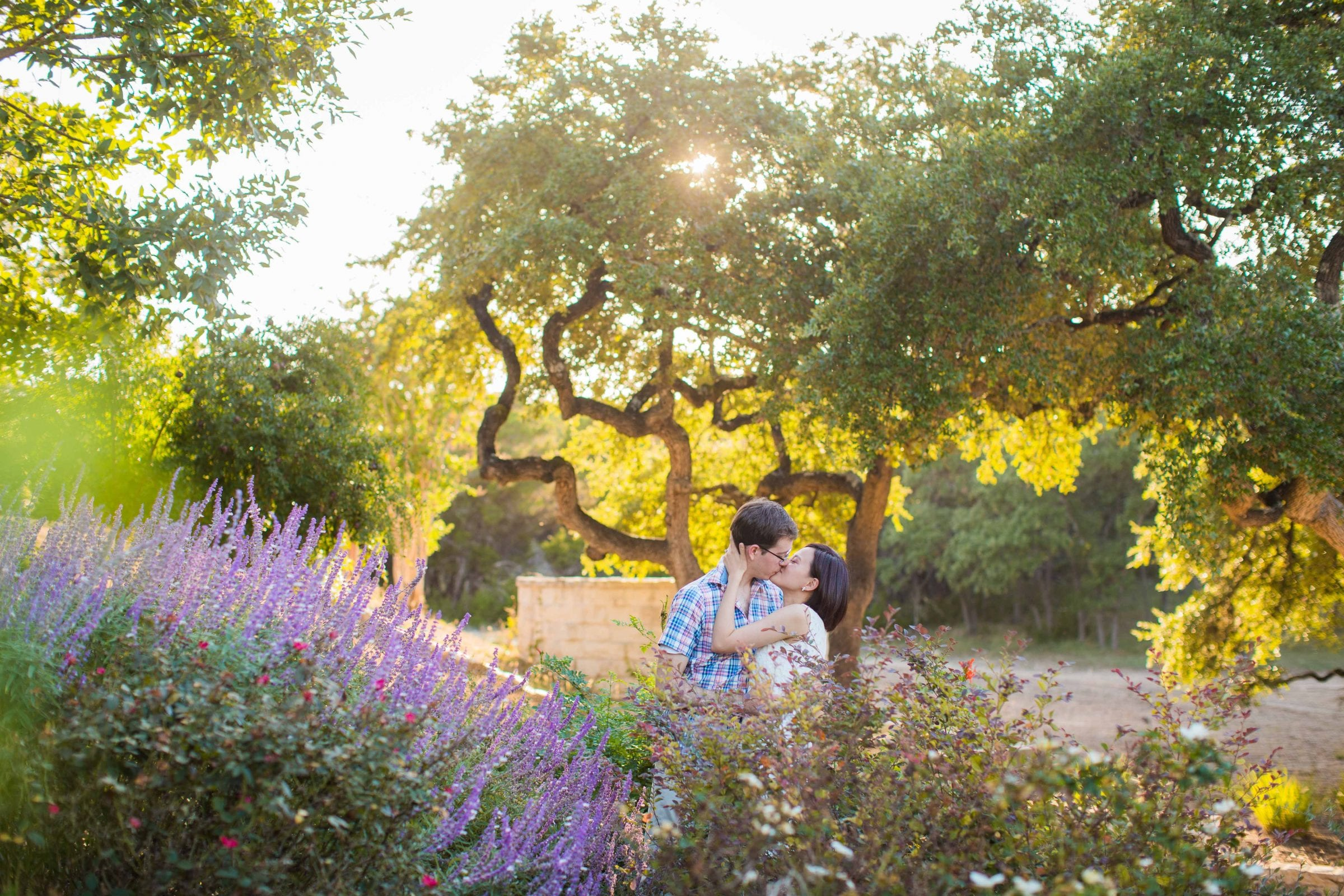 Josh and Tina engagement session at Kendall plantation kiss in the garden