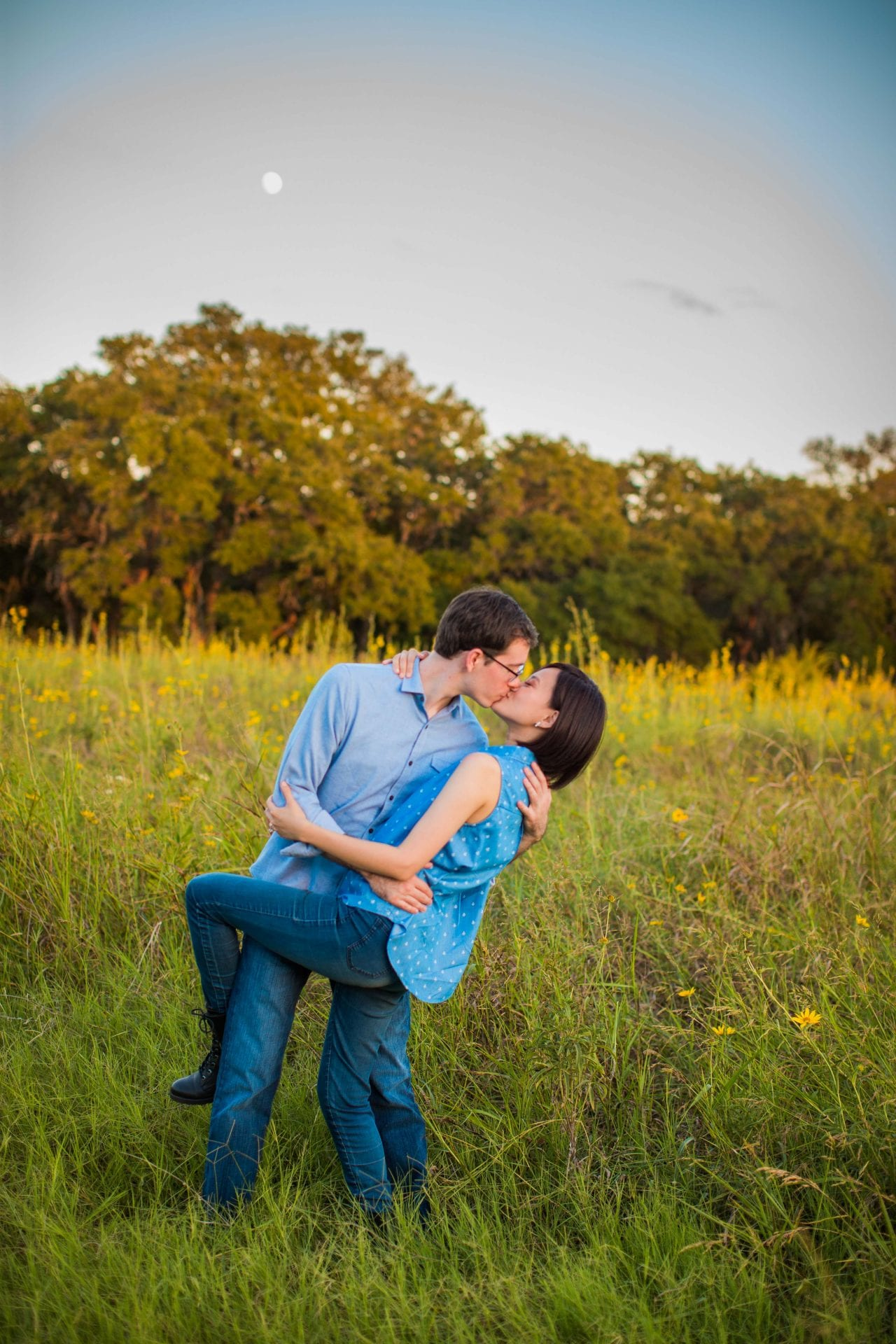 Josh and Tina engagement session at park in tall grass dip