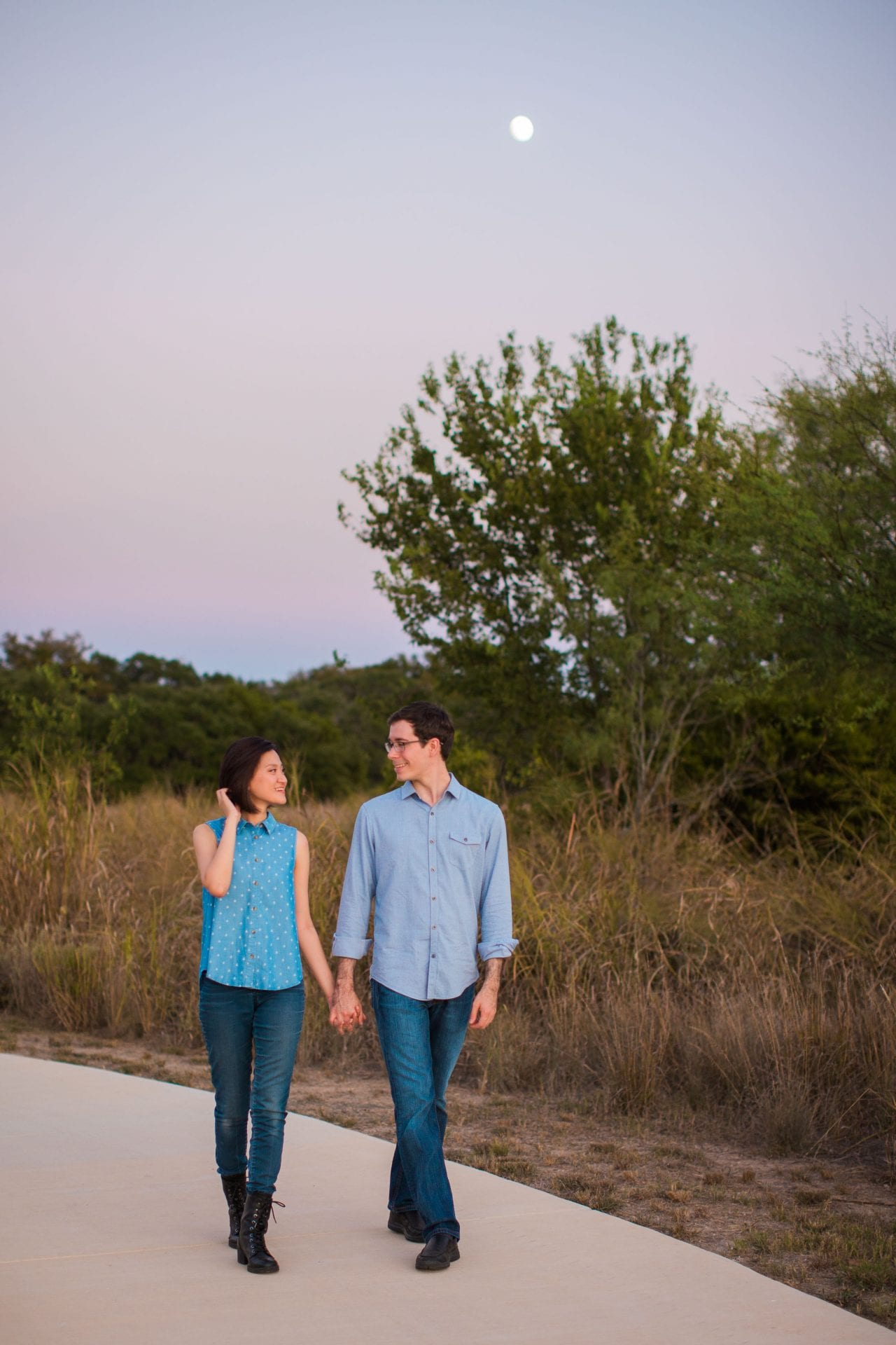 Josh and Tina engagement session at park on the path walking