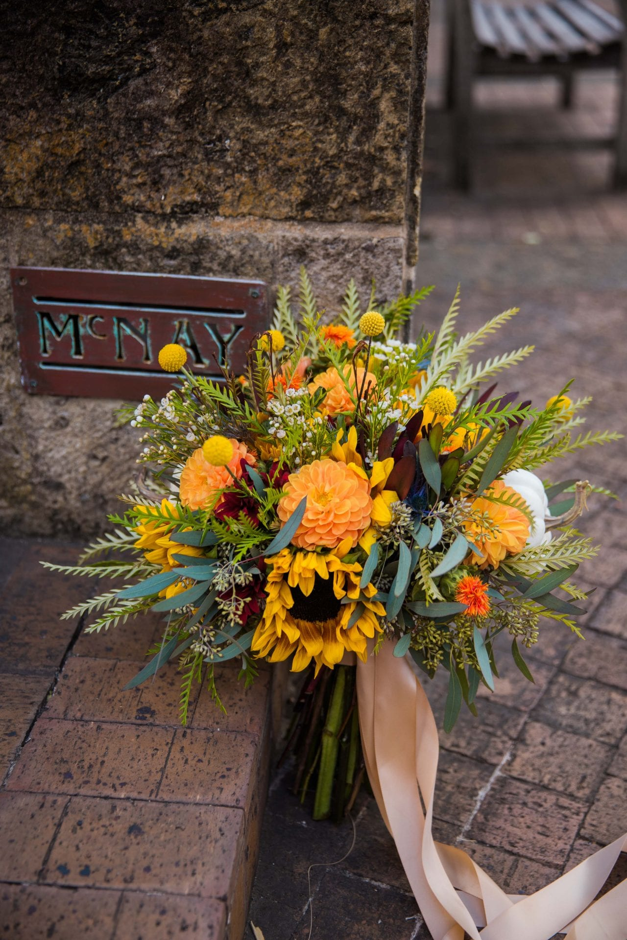 Fall styled shoot at the McNay art museum flowers by the sign