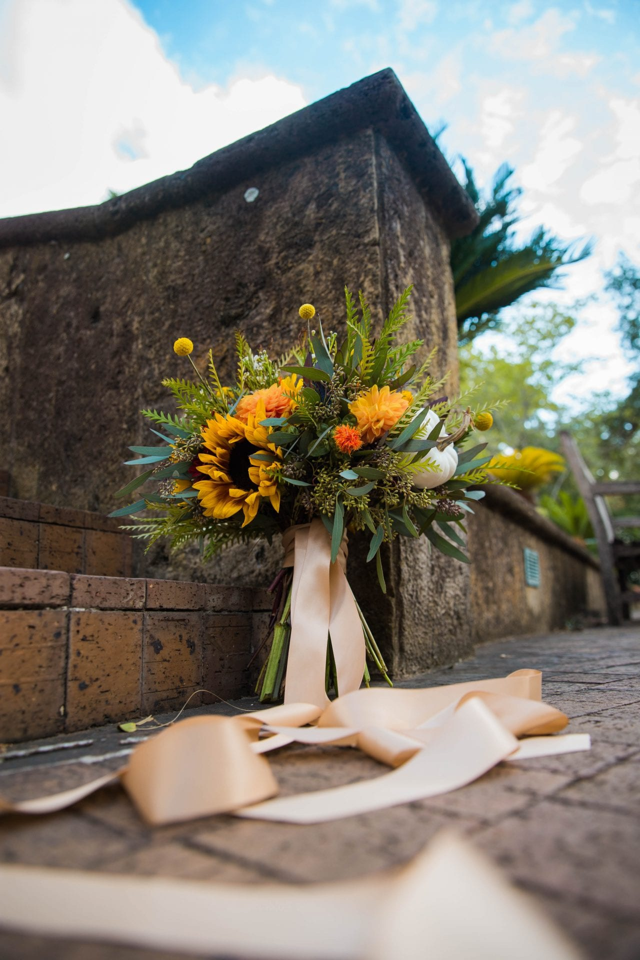 Fall styled shoot at the McNay art museum flowers on the ground
