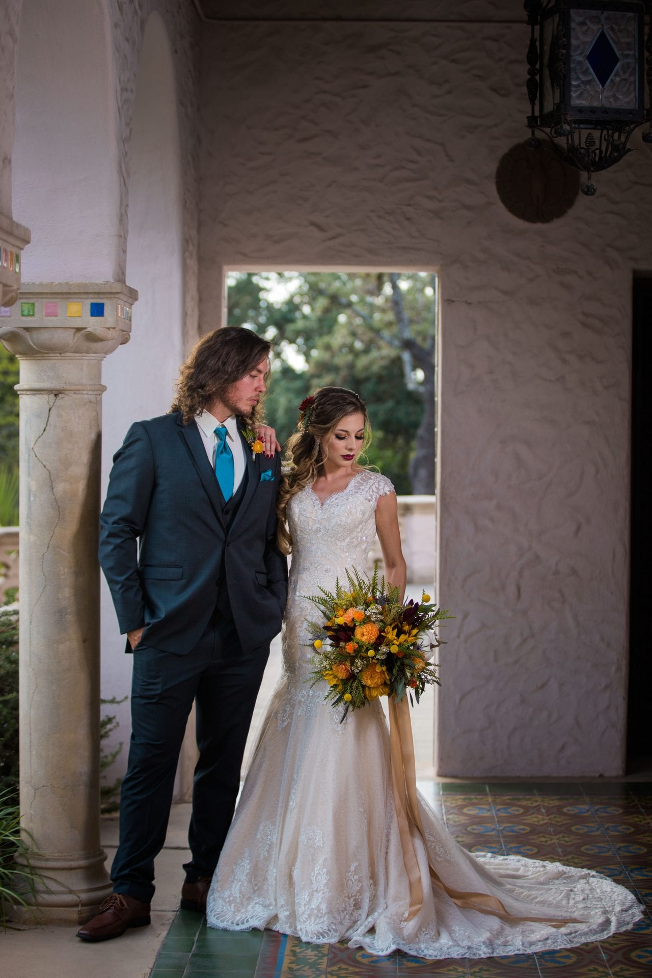 Fall styled shoot at the McNay art museum couple in arches looking down