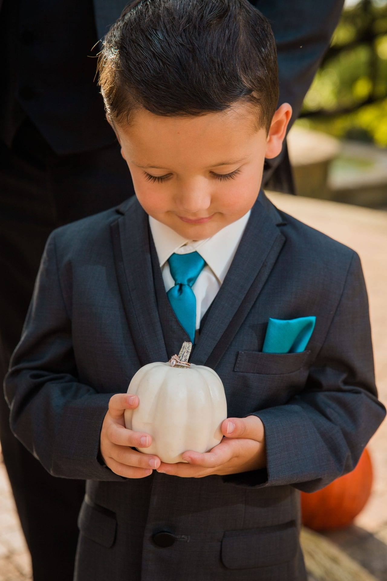 Fall styled shoot at the McNay art museum kid with pumpkin