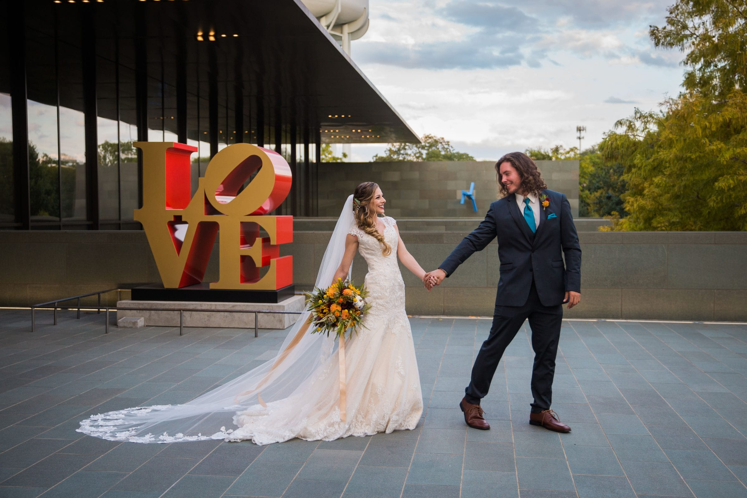 Fall styled shoot at the McNay art museum couple at LOVE letters