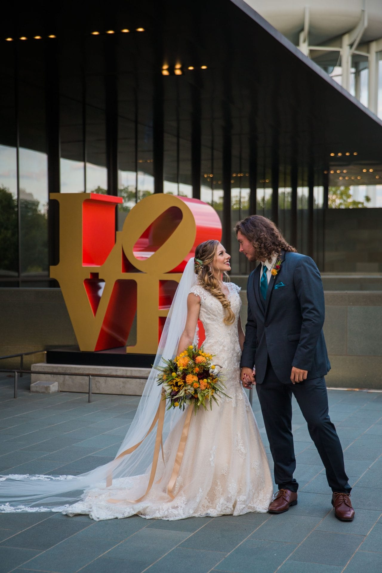 Fall styled shoot at the McNay art museum couple at LOVE letters close