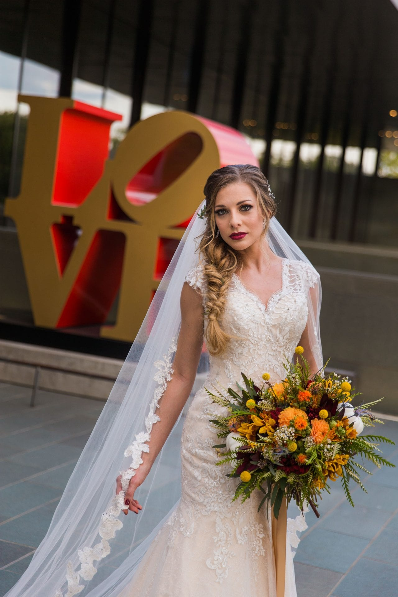 Fall styled shoot at the McNay art museum bride close up at LOVE letters