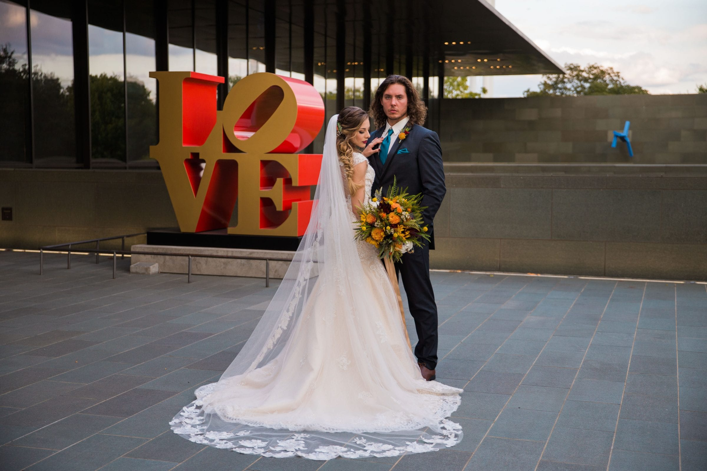 Fall styled shoot at the McNay art museum couple close up back at love letter
