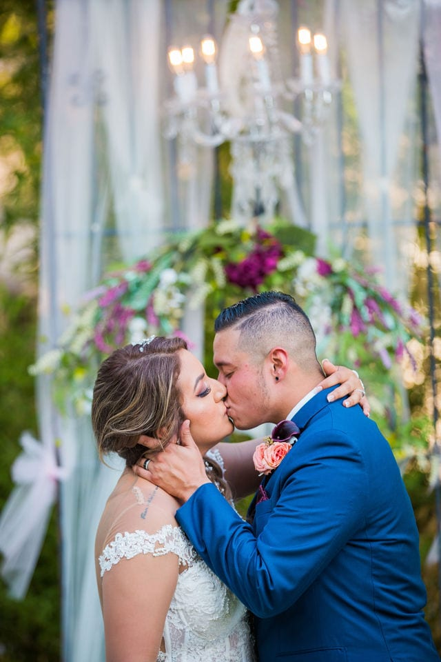 Ashley and Andy wedding Lambermont events kiss at the arch cp