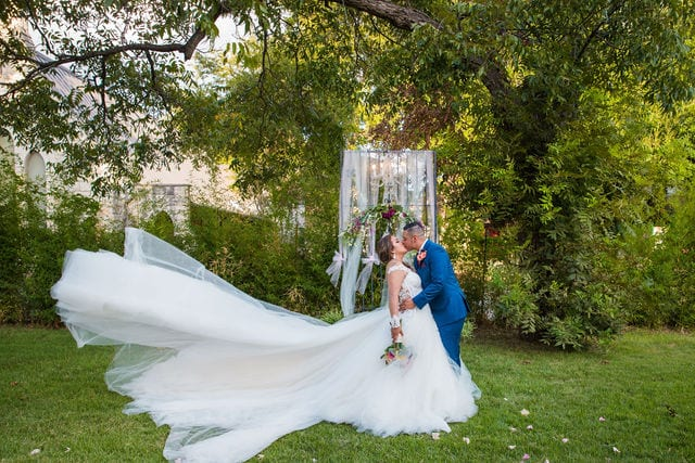Ashley and Andy wedding Lambermont events kiss at the arch