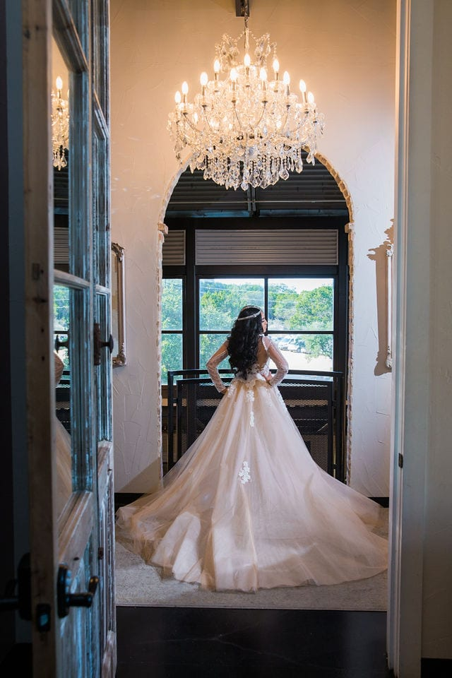 Erica and Mark's wedding at Park 31 wedding bride in upstairs Hall looking out