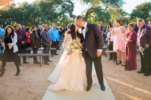 Erica and Mark's wedding at Park 31 wedding kiss on aisle
