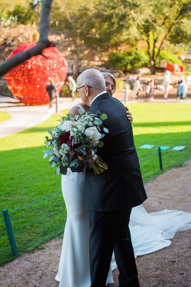 Michele's wedding at La Cantera dad's first look hug