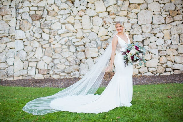 Michele's wedding at La Cantera bridal by the stone wall