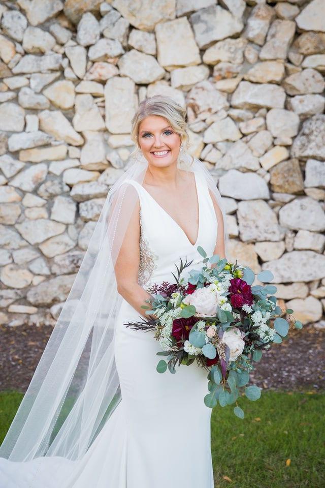 Michele's wedding at La Cantera bridal by the stone wall headshot