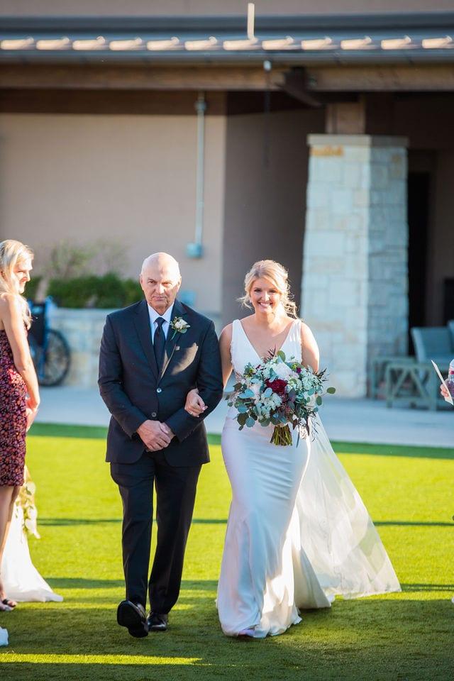 Michele's wedding at La Cantera walk down the aisle