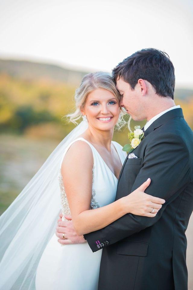 Michele's wedding at La Cantera wedding kiss bride looking at groom