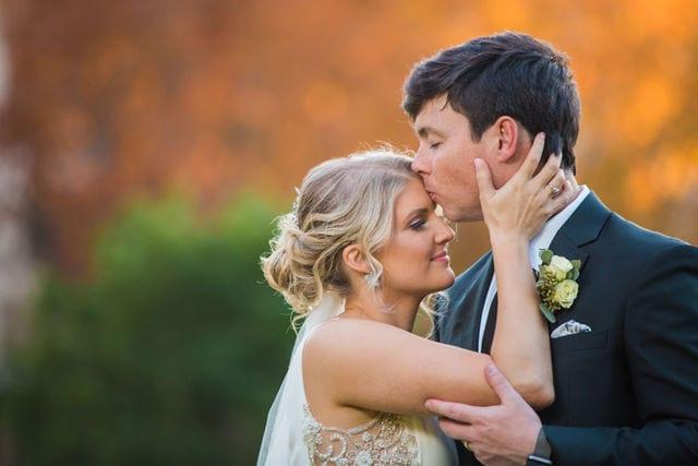 Michele's wedding at La Cantera wedding groom kissing brides forehead