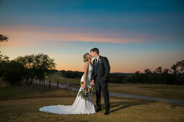 Michele's wedding at La Cantera wedding bride and groom sunset on the hill