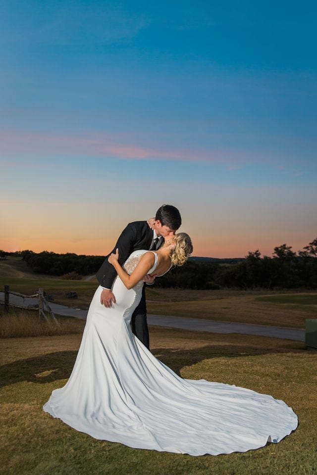 Michele's wedding at La Cantera wedding bride and groom sunset on the hill dip