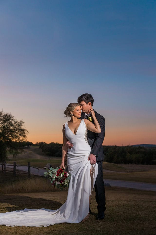 Michele's wedding at La Cantera wedding bride and groom sunset on the hill sexy