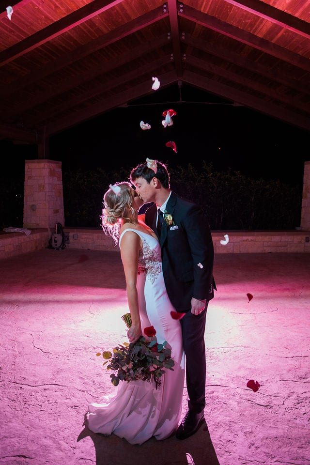Michele's wedding at La Cantera wedding rose petals falling with pink