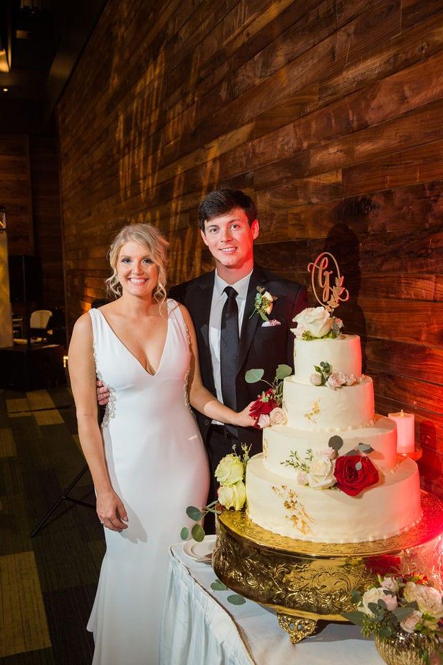 Michele's wedding at La Cantera wedding cake cutting