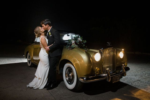 Michele's wedding at La Cantera wedding fancy car kiss