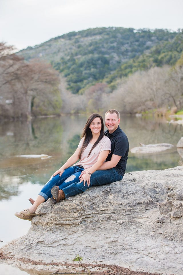 Stefan and Ashley's engagement session. Sitting on the river rock.