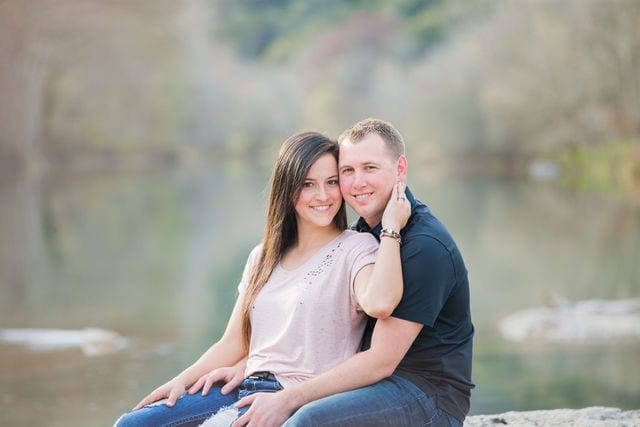 Stefan and Ashley's engagement session. Couple dreamy by the river on the rock