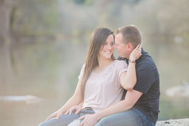 Stefan and Ashley's engagement session. Couple dreamy on the river on the rock