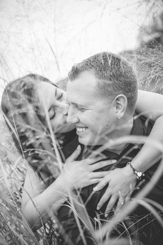 Stefan and Ashley's engagement session in the tall grass bw